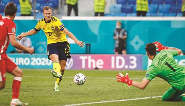 Sweden's Viktor Claesson (centre) scores against Poland during the Euro 2020 Group E match at the Sa