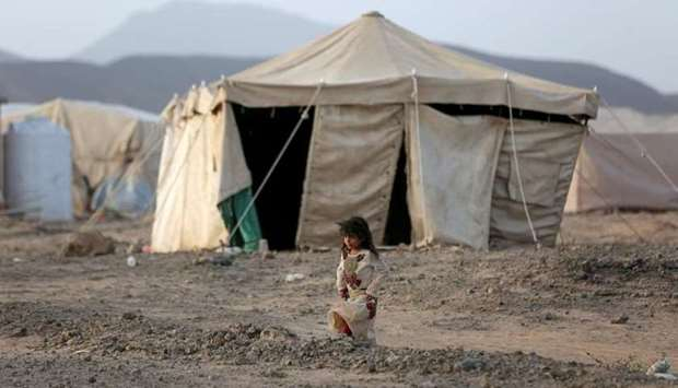 A girl walks past a tent at a camp for internally displaced people (IDPs) in Marib, Yemen April 5. R