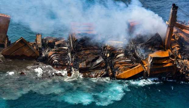 Smoke rises from a fire onboard the MV X-Press Pearl vessel as it sinks while being towed into deep