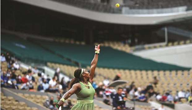 Serena Williams of the US serves the ball to compatriot Danielle Collins (not pictured) during their