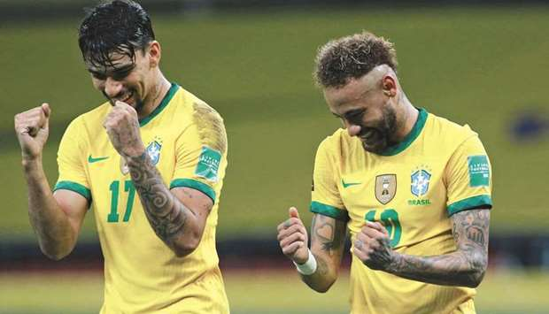 Brazil's Neymar (right) celebrates with teammate Lucas Paqueta after scoring a penalty against Ecuad