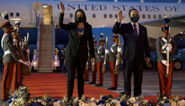 US Vice President Kamala Harris and Guatamala's Foreign Minister Pedro Brolo wave upon her arrival a