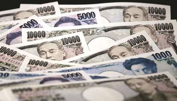 Japanese yen banknotes of various denominations are arranged for a photograph in Tokyo. The yen has