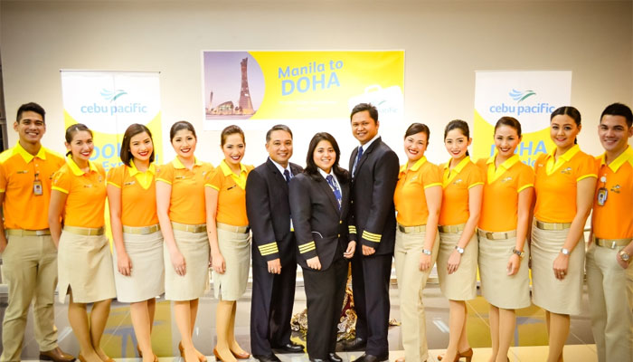 Cebu Pacific Air crew pose with officials