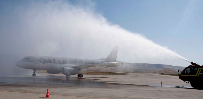 The maiden Qatar Airways flight being welcomed with a water salute at Sulaymaniyah International Air