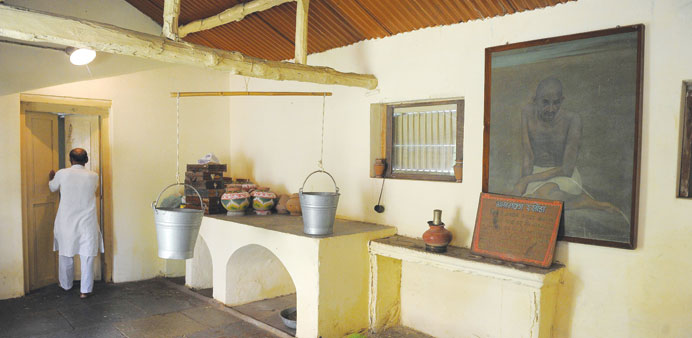 Ashram co-ordinator Rameshbhai Trivedi walks through the kitchen and dining area at Kochrab Ashram,