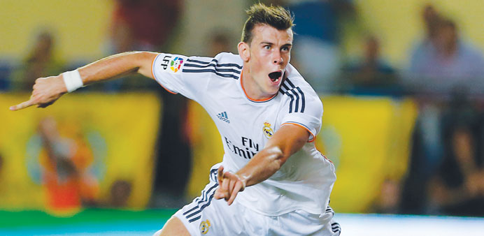 Real Madrid's Welsh striker Gareth Bale celebrates after scoring during the Spanish league match aga