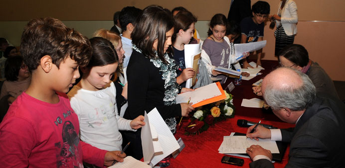 Ambassadors share their time with young students.