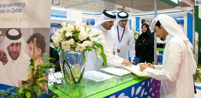 An  applicant  filling a form at the HMC stand at the career fair.