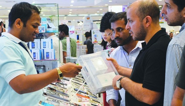 Customers line up for smartphones, which saw an increase in sales during Eid al-Fitr.