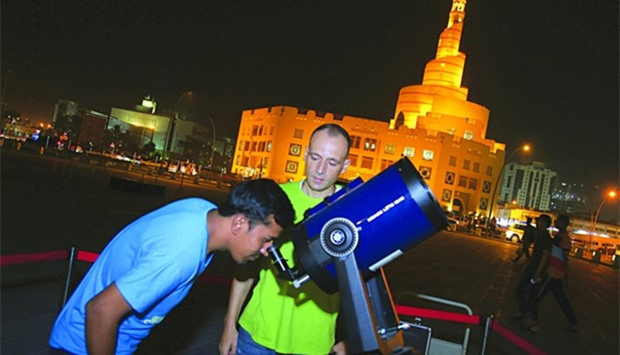 Egyptian astronomer Amro Mahmoud gives Souq Waqif visitors a chance to see some planets through his