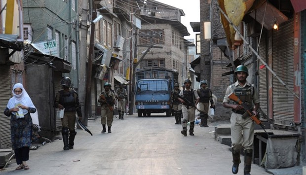 Indian paramilitary soldiers patrol the streets during a curfew in downtown Srinagar.
