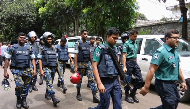 Security personnel are seen near the Holey Artisan restaurant hostage site, in Dhaka,