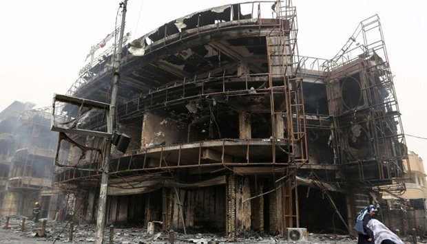 A damaged building at the site of a suicide car bombing
