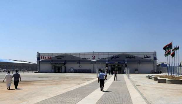 People walk at Benina airport east of Benghazi, Libya