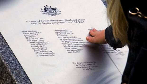 A relative of an Australian victim of Malaysia Airlines jet MH17 touches a memorial