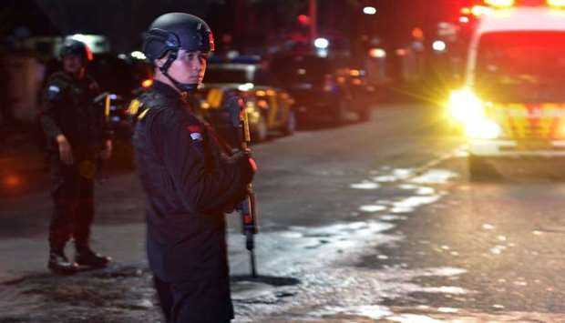 Indonesian police step up security after an attack by a suspected Islamist militant who stabbed two