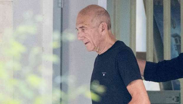Former PM Olmert goes home after serving partial sentence