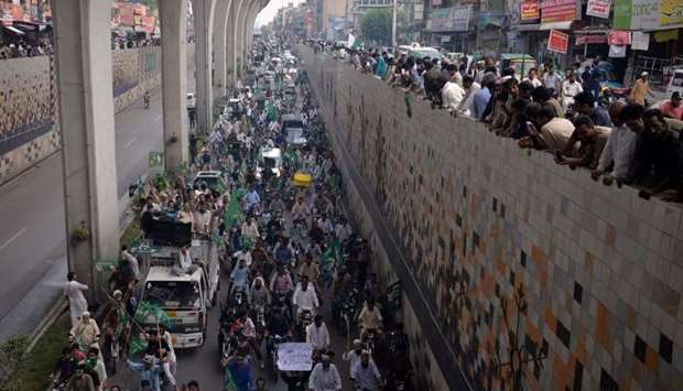 Supporters of ousted Pakistani prime minister Nawaz Sharif march during a rally in Rawalpindi