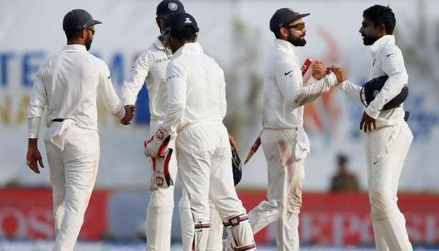 India's captain Virat Kohli and Abhinav Mukund celebrate with their teammates after winning the matc