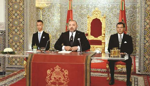 Morocco's King Mohamed VI (centre) delivers a speech to mark the 16th anniversary of his accession t