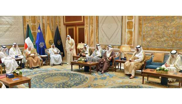 Emir of Kuwait, reading a message received from His Highness the Emir Sheikh Tamim bin Hamad al-Than