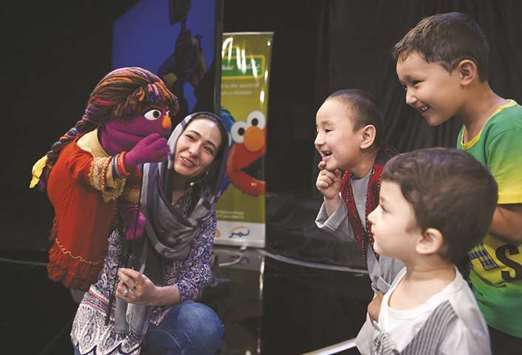 Woman's place is beyond the home. Afghanistan's Sesame Street gets proud brother muppet
