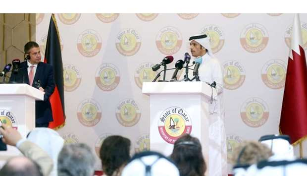 Gabriel and Shiekh Mohamed addressing a joint news conference in Doha