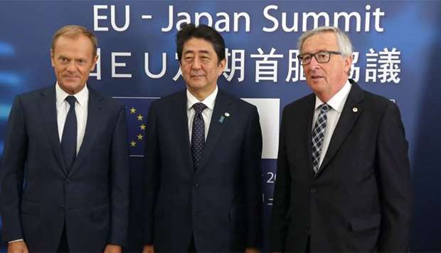 European Council President Donald Tusk (L), Japanese Prime Minister Shinzo Abe (C) and President of