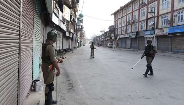 Indian paramilitary troopers patrol during a curfew in Srinagar