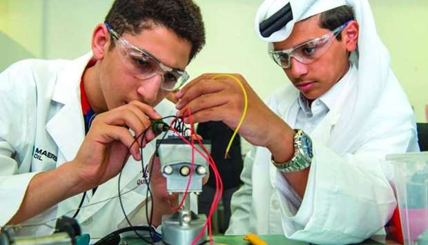 Two students engaged in a project work.