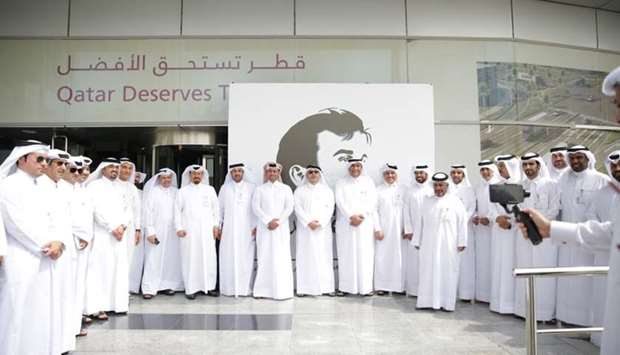 Ashghal officials mark the launch of the 'Tamim Al Majd' initiative at their head office.