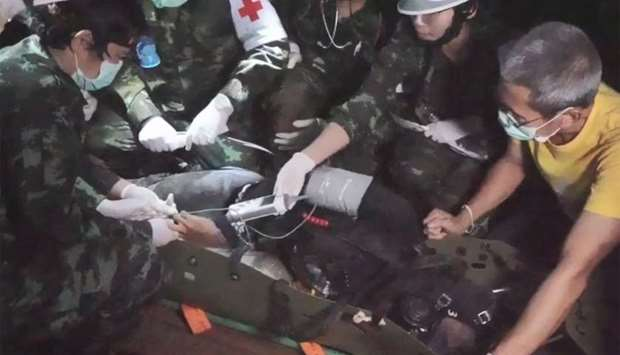 "A member of the ""Wild Boars"" Thai youth football team being moved on a stretcher during the rescue o"