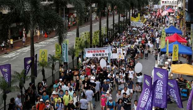 Protesters take part in a march in Hong Kong