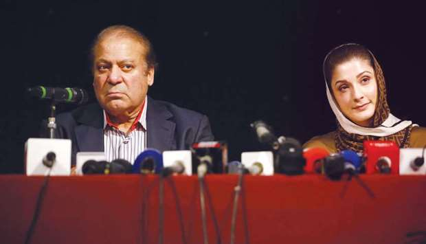 Nawaz Sharif, left, and his daughter Maryam Nawaz attend a UK PML-N Party Workers Convention meeting