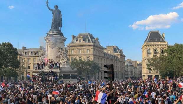 People celebrate on the Place de la Republique