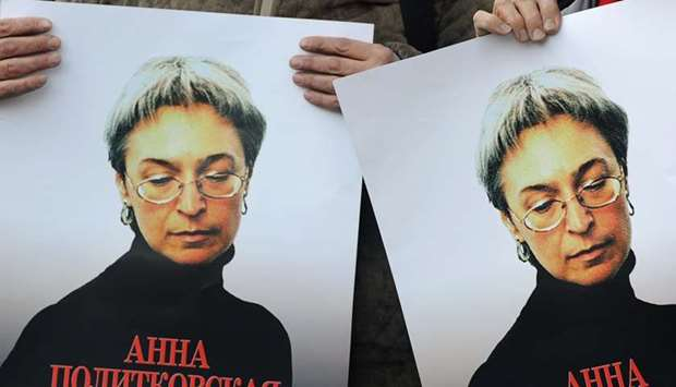 Russian human rights activists attend a rally in honour of slain Russian journalist Anna Politkovska