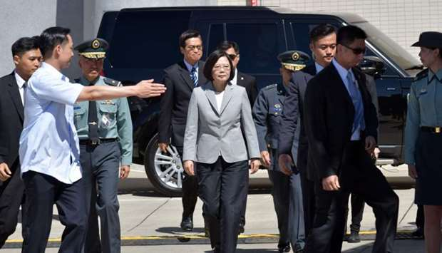 Taiwan's President Tsai Ing-wen (C) arrives for a ceremony to commission new US-made Apache AH-64E a