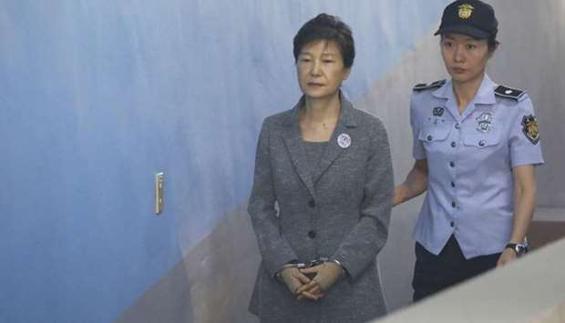 South Korean ousted leader Park Geun-hye (L) arriving at a court in Seoul. File photo taken on Augus