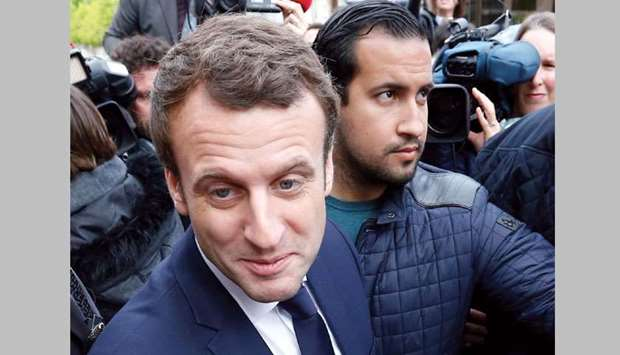 Macron fires bodyguard who was filmed beating protester