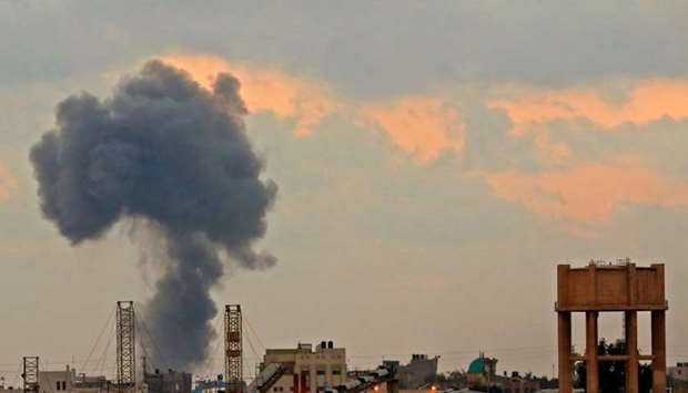 A smoke plume rising from an explosion during Israeli bombardment yesterday in Gaza City