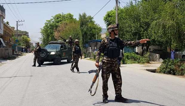 Afghan security forces arrive at an area where explosions and gunshots were heard, in Jalalabad
