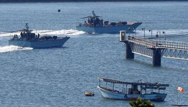 Israeli navy ships manoeuvre at the military port of Ashdod, southern Israel