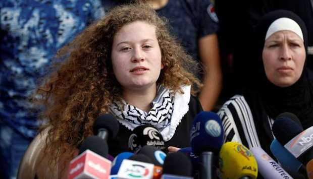Palestinian teenager Ahed Tamimi speaks during a news conference after she was released from an Isra