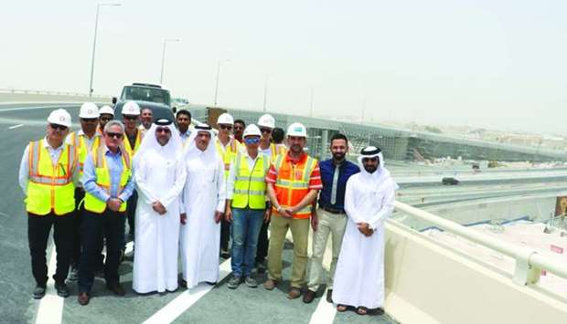 Officials of Ashghal and contracting companies on the newly commissioned section of the Bani Hajer i