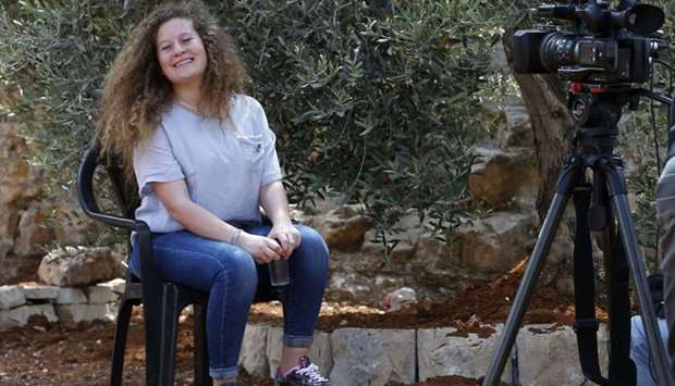 Palestinian activist and campaigner Ahed Tamimi, 17, smiles during an interview with AFP in the West