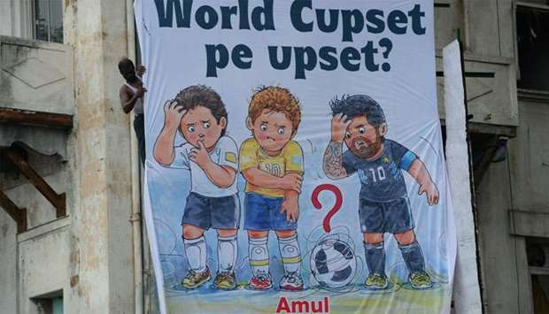An Amul dairy products billboard on the side of a building in Mumbai.