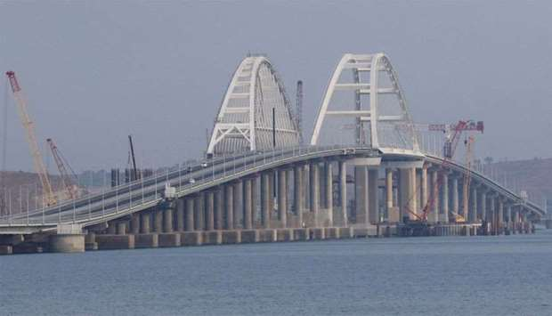 Cars drive along a bridge, which was constructed to connect the Russian mainland with the Crimean Pe