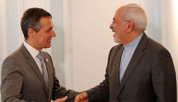 Swiss Foreign Minister Ignazio Cassis with Iranian counterpart Mohammad Javad Zarif