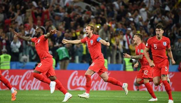 England's team players celebrate after winning